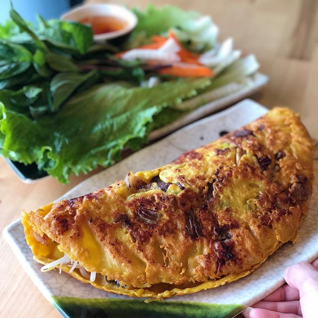 "Em will be featuring Banh Xeo, a turmeric based Vietnamese crepe with pork belly, prawns and beansprouts as our weekend special 11/17-11/18 😋The ""Xeo"" actually is onomatopoeia that refers to the sizzling sound the crepe makes as it hisses and crackles on the pan! 👩‍🍳🥞 🔥😍😋 ⁣⁣ ⁣⁣ ⁣⁣ ⁣⁣ ⁣⁣ ⁣⁣ #eaterny #timeoutnewyork #devourpower #tastingtable #buzzfeed #insidernewyork #eeeeeats #foodoftheday #forkyeah #foodstagram #foodnetwork #nyceats #newyorkmagazine #seriouseats #lovefood #nomnomnom #nomnom #myfab5 #nycdining #topcitybites  #bensonhurst #heresmyfood #foodadventure #foodiefeature #foodislove #grubstreet #banhxeo"