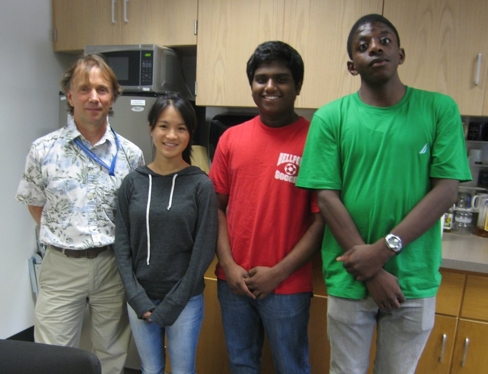 Brookhaven National Lab student interns Greta Huang (2nd left) and Collin Francis (last right) make presentations August 9th at the NASA Space Radiation Lab. Thank you Dr. Michael Sivertz and Dr. Stefan Tafrov for taking time out of their schedule.