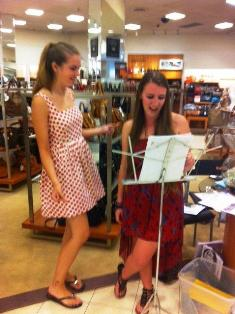 Shopping For a Cause Fundraiser. Making music at Macy's, Kayla Neville  and Nikki Rodgers.