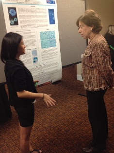 Dr. Birnbaum taking a moment to hear about Greta's study at Brookhaven National Laboratory.