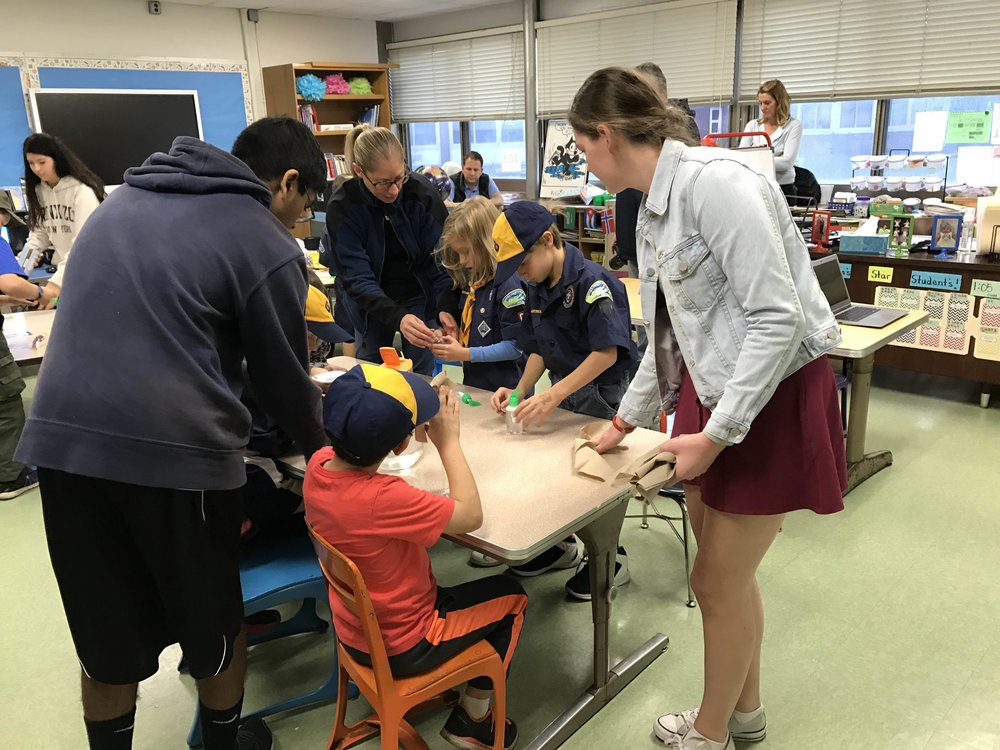 Erin and Karthi helping some students at an outreach with local Cub Scouts