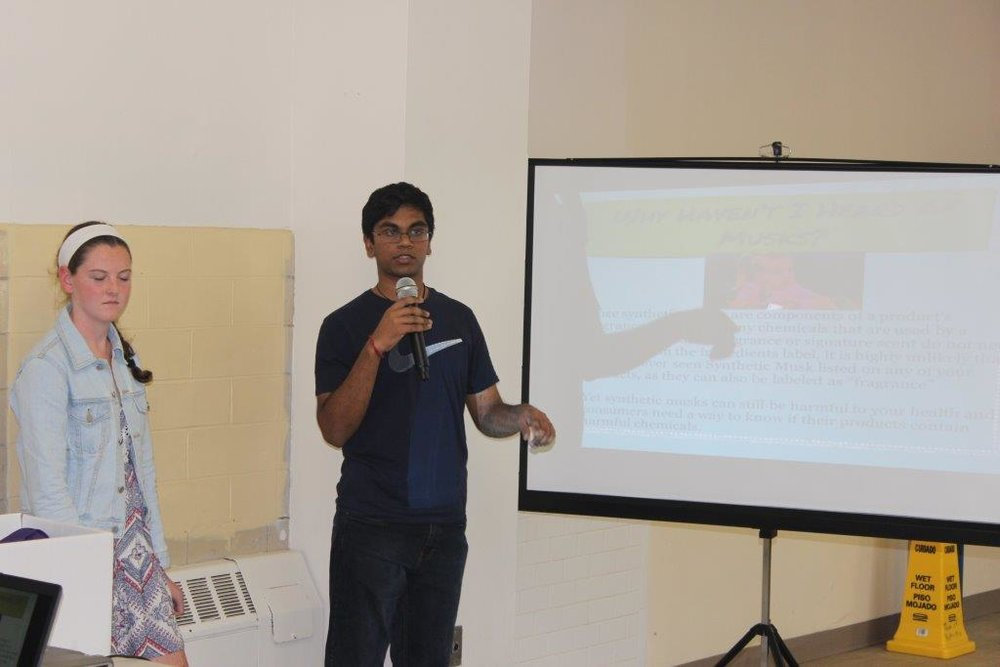 Karthi speaking at an outreach at the Senior Center