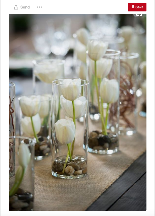 A simple arrangement of tulips in water make for an elegant and beautiful centerpiece.