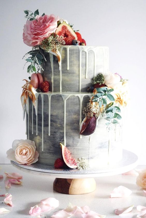 You don't even have to go crazy with the color. Whether you're having a vintage wedding, winter wedding, or a subtle beach wedding, color drip wedding cakes are perfect for any occasion.