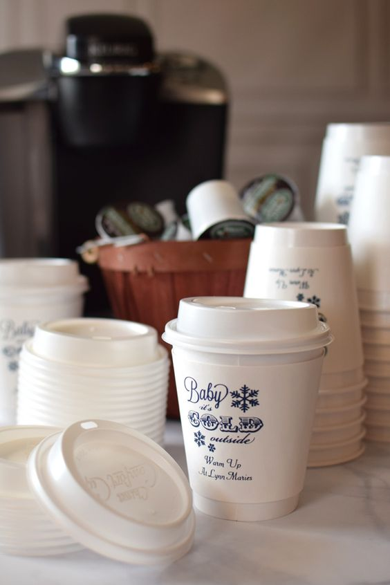 And why stop at the hot chocolate and sweet treats at your wedding? Did you know that you can get customized coffee cups and holders for your wedding? How cute is that idea?