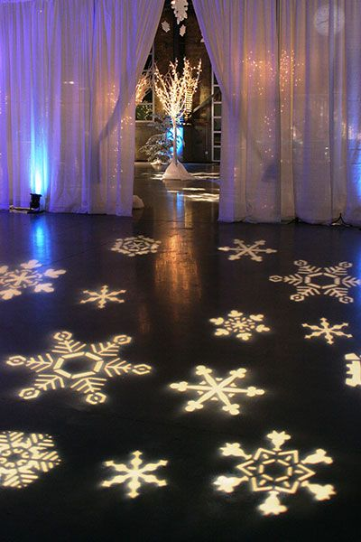 What do you think about the idea of using projection lighting for snowflakes on the dance floor? Or, perhaps, hearts or abstract art?