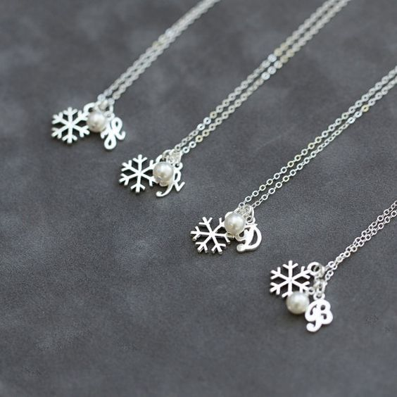 And what better way to thank your wedding party and bridesmaids than to give them snowflake jewelry as they stand beside you on your snowy wedding day?
