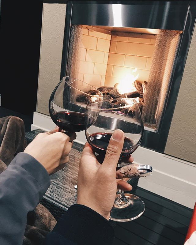 Relaxing by our beautiful outdoor fireplace.  Cheers boo! #slicedfinger #chill #love #homesweethome