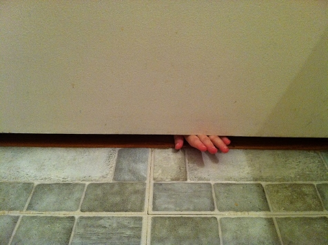 Hand under the door, no moments peace