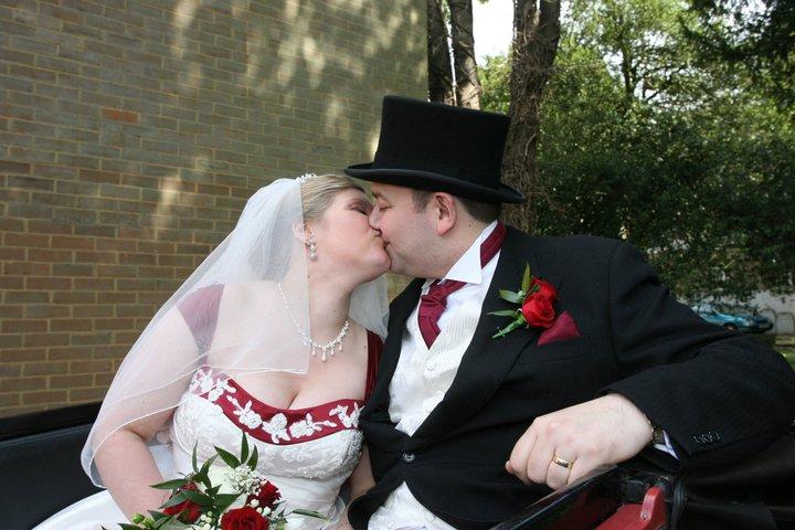 husband and wife wedding day kiss © mebecomingmum