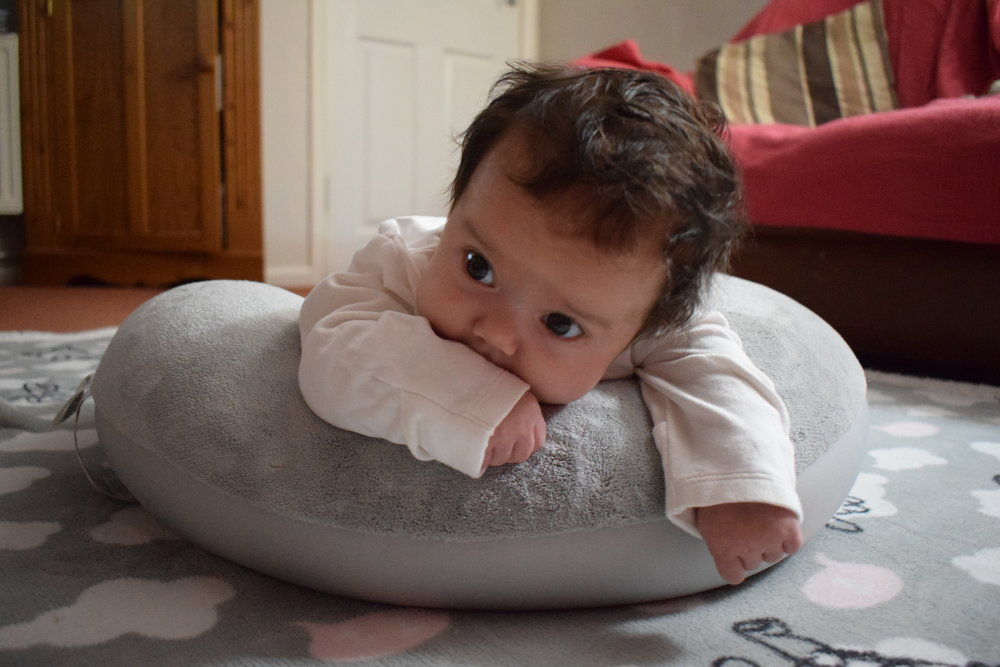 Tummy time on the Theraline Plushy Moon breastfeeding nursing pillow