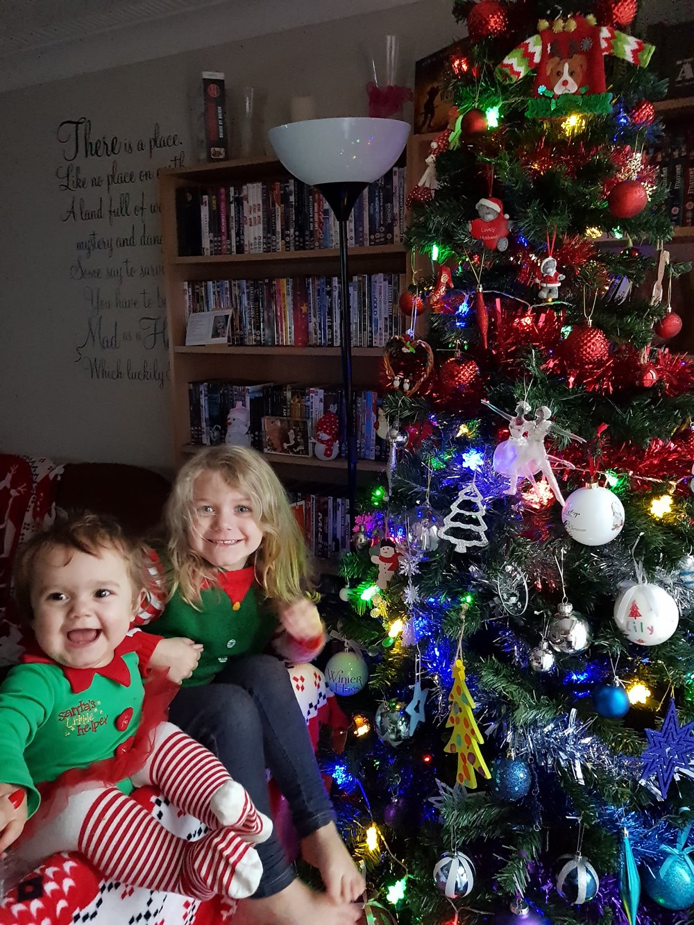 Excited children and rainbow Christmas tree