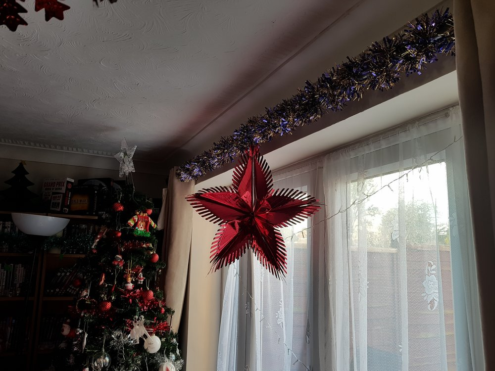 Christmas tree, tinsel and foil star decoration