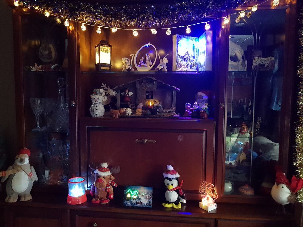 Sideboard full of Christmas decorations and lights