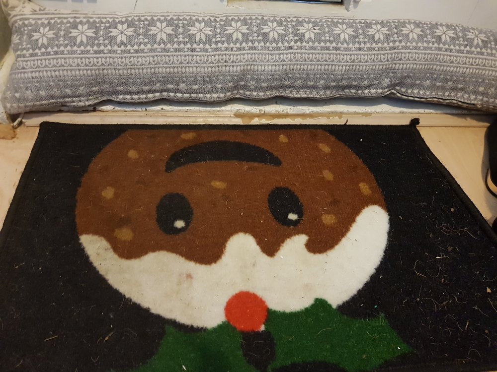 Christmas pudding door mat and snowflake draught excluder