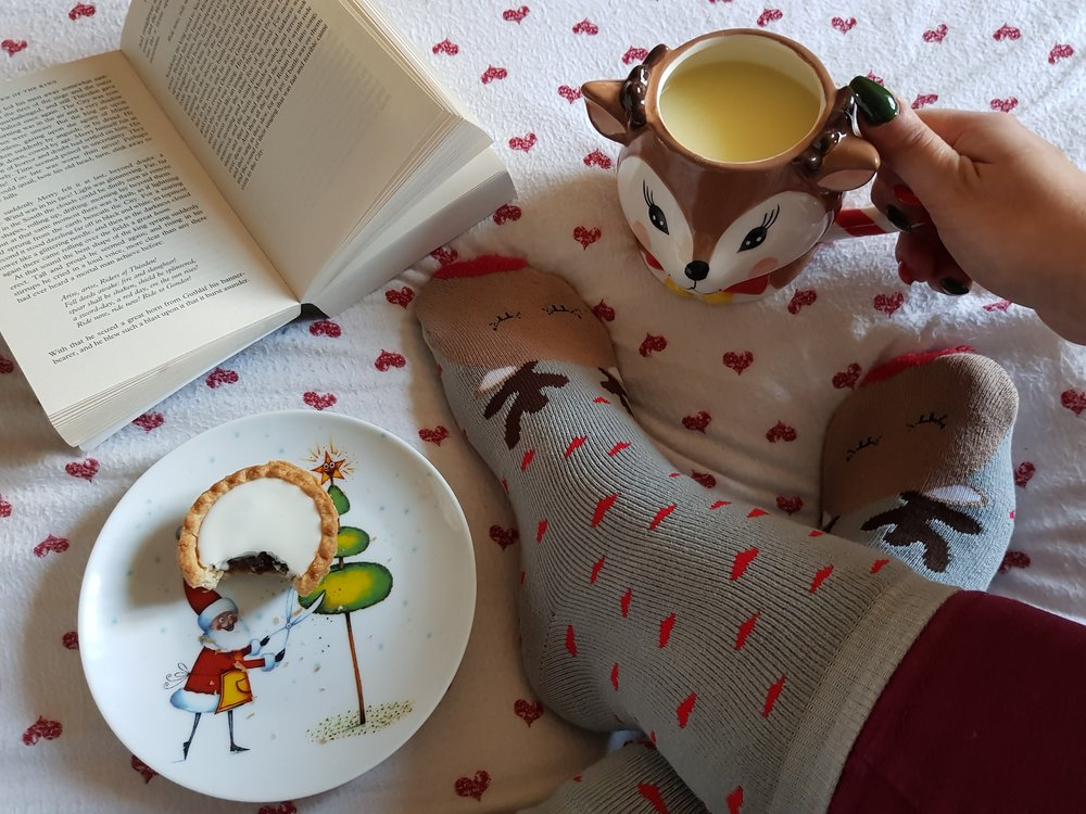 Mince pie, book, hot chocolate and Christmas socks