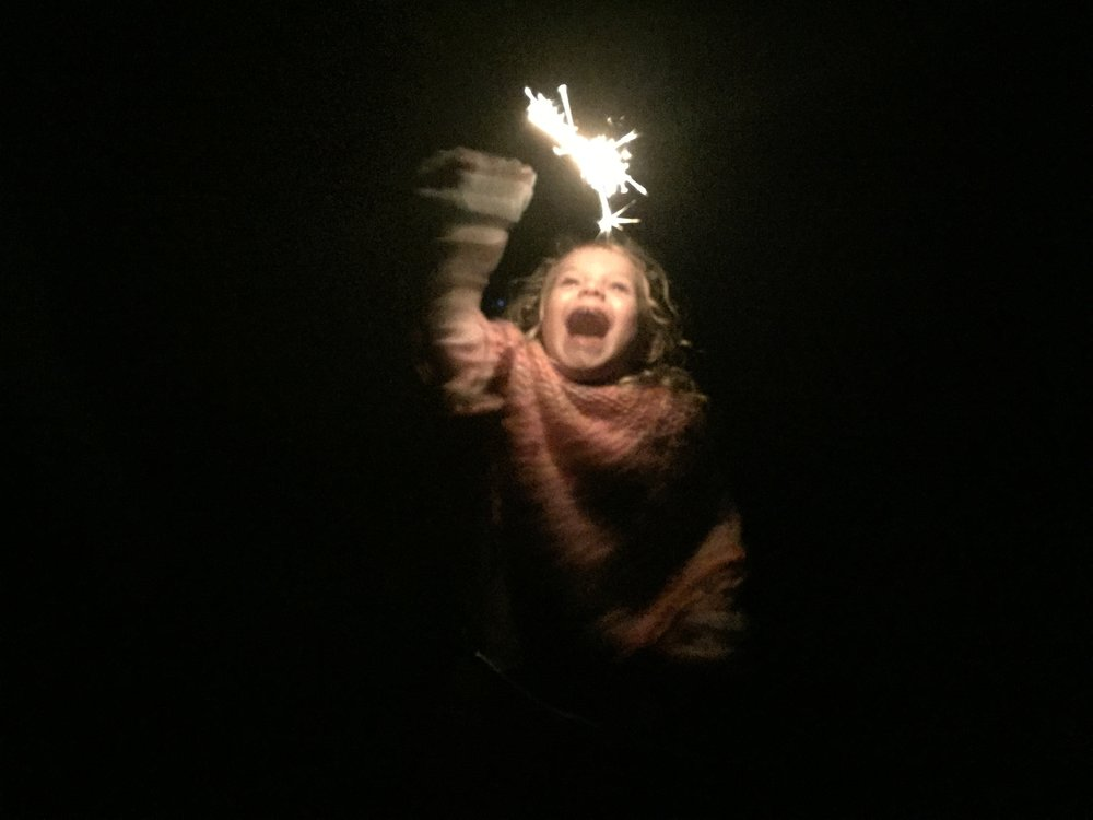 The happiest girl there ever was with a sparkler