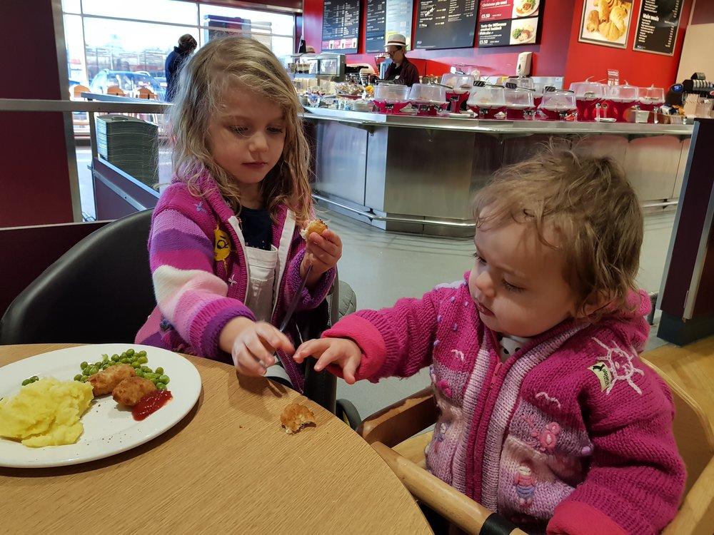 My girls sharing their Sainbury's Café lunch