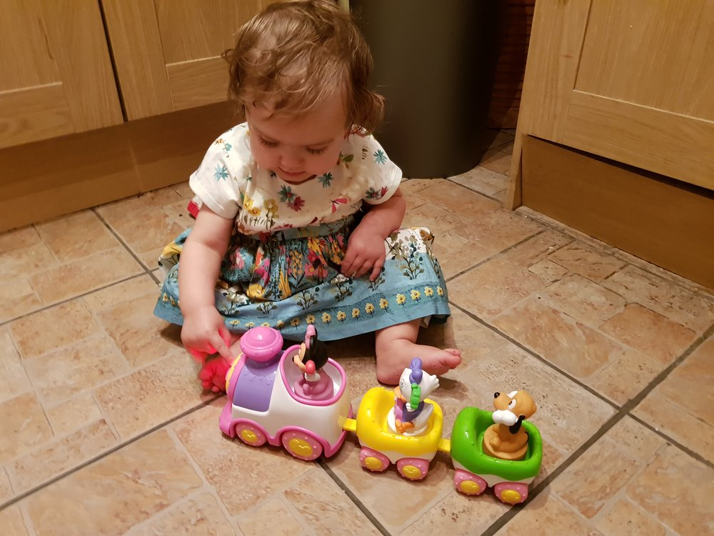 Pickle and her Minnie Mouse Disney toy train