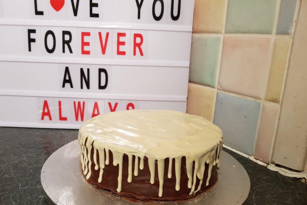 My hubby's homemade white chocolate drip birthday cake