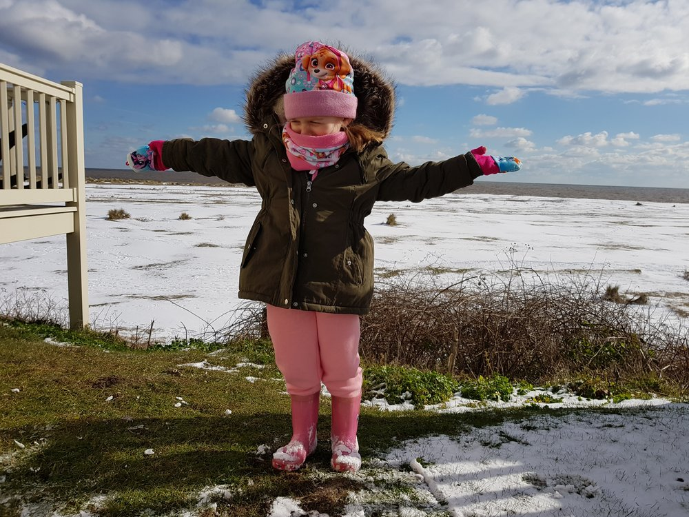 Holiday by the beach in the snow