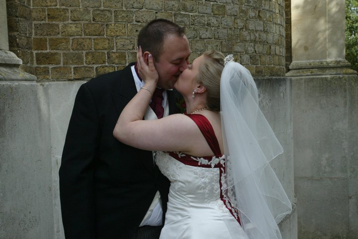 Newly wed kisses outside the church