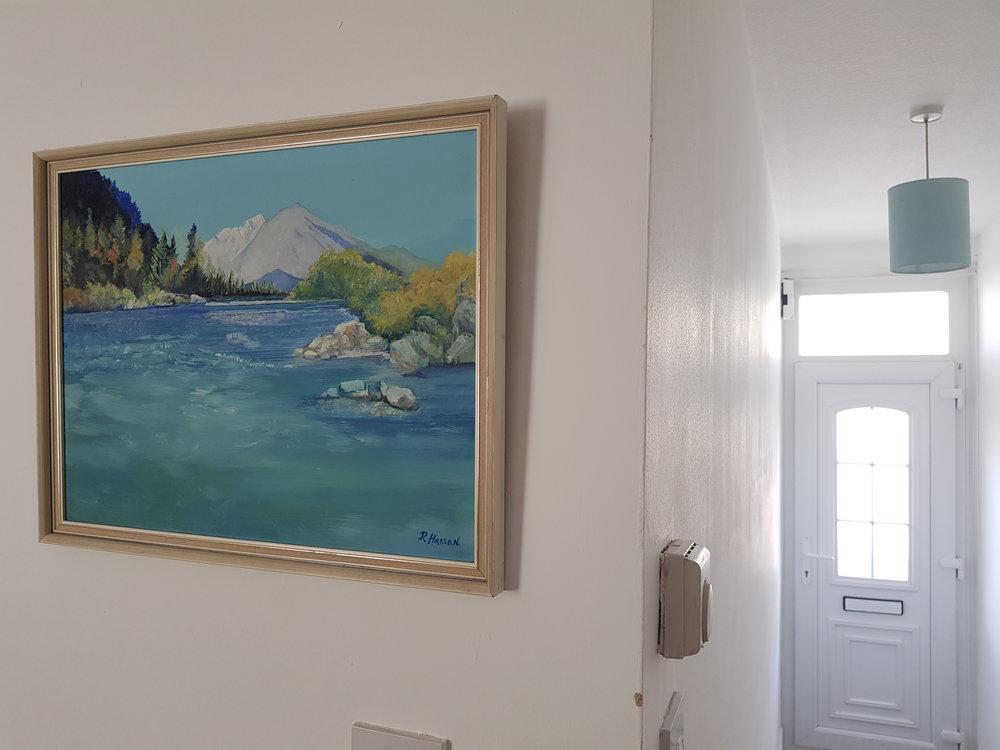 Landscape painting hung on our wall