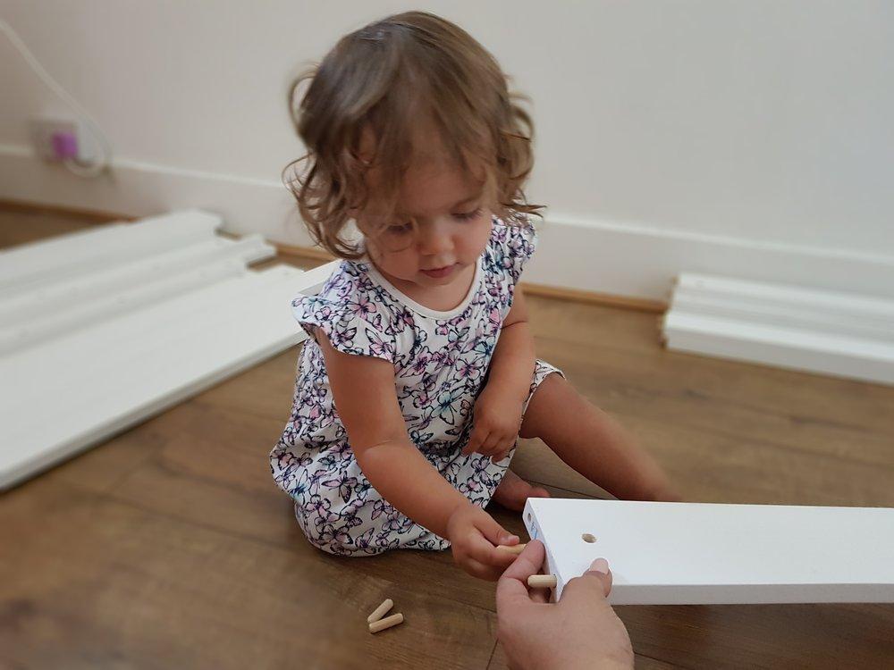 Mummy's little helper building the bunk bed