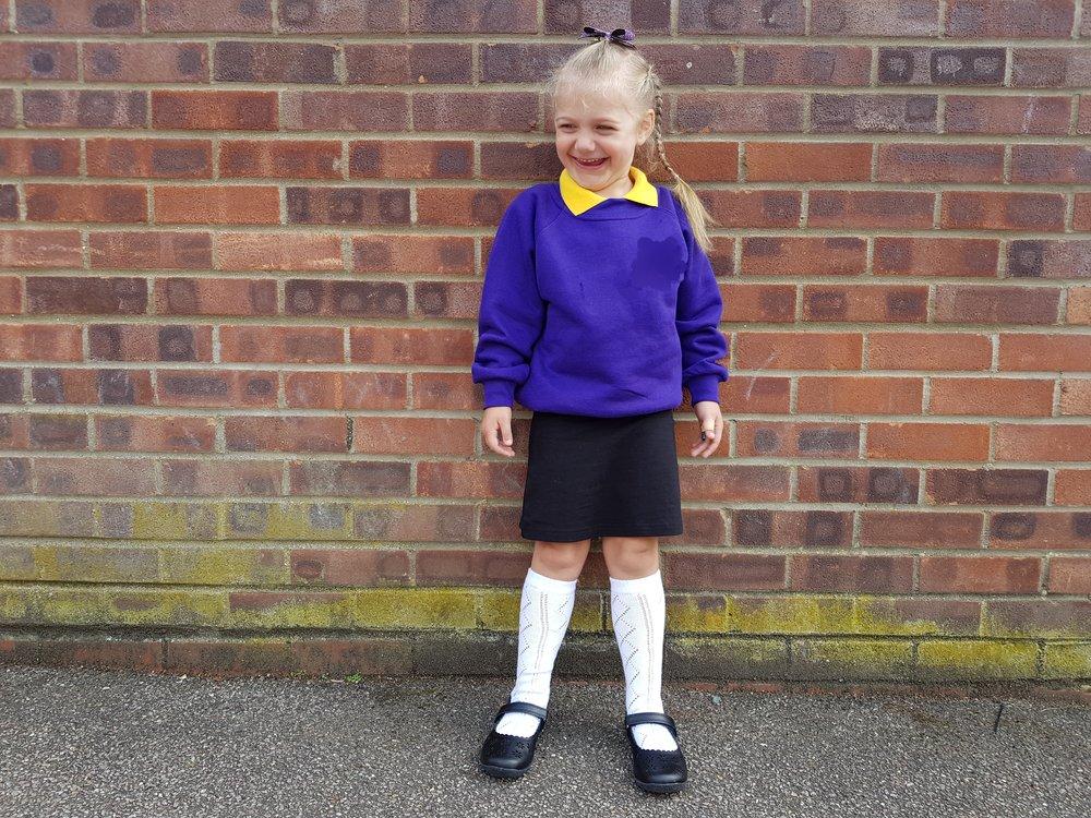 My grown up girl in her first school uniform