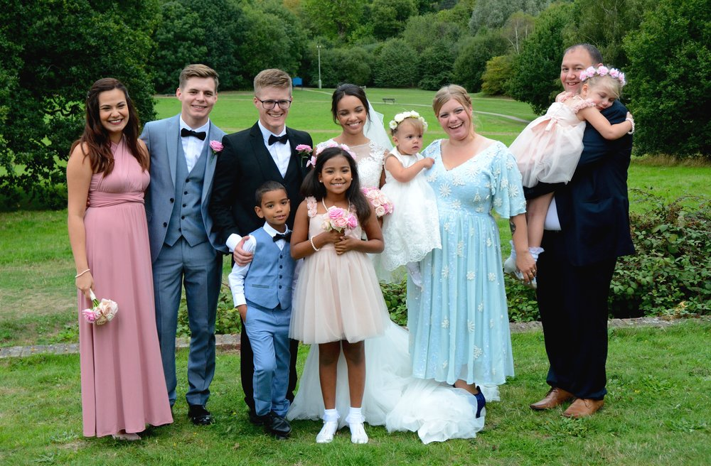 Siblings and their families wedding photo