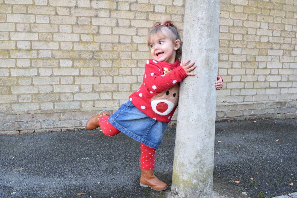 Pickle messing about in her Christmas jumper outside