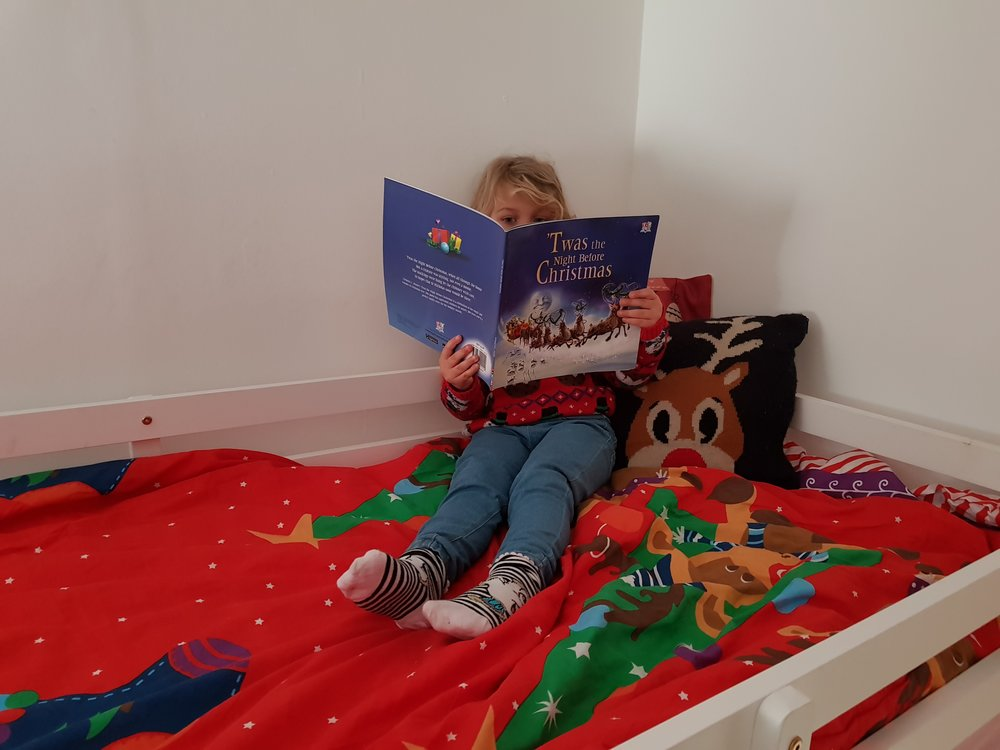 Reading Christmas books in bed after school