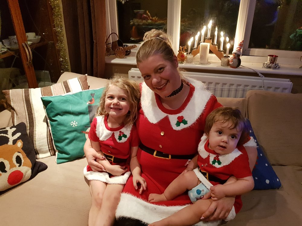 Christmas through the years, dressed in matching Santa dresses from Primark 2017