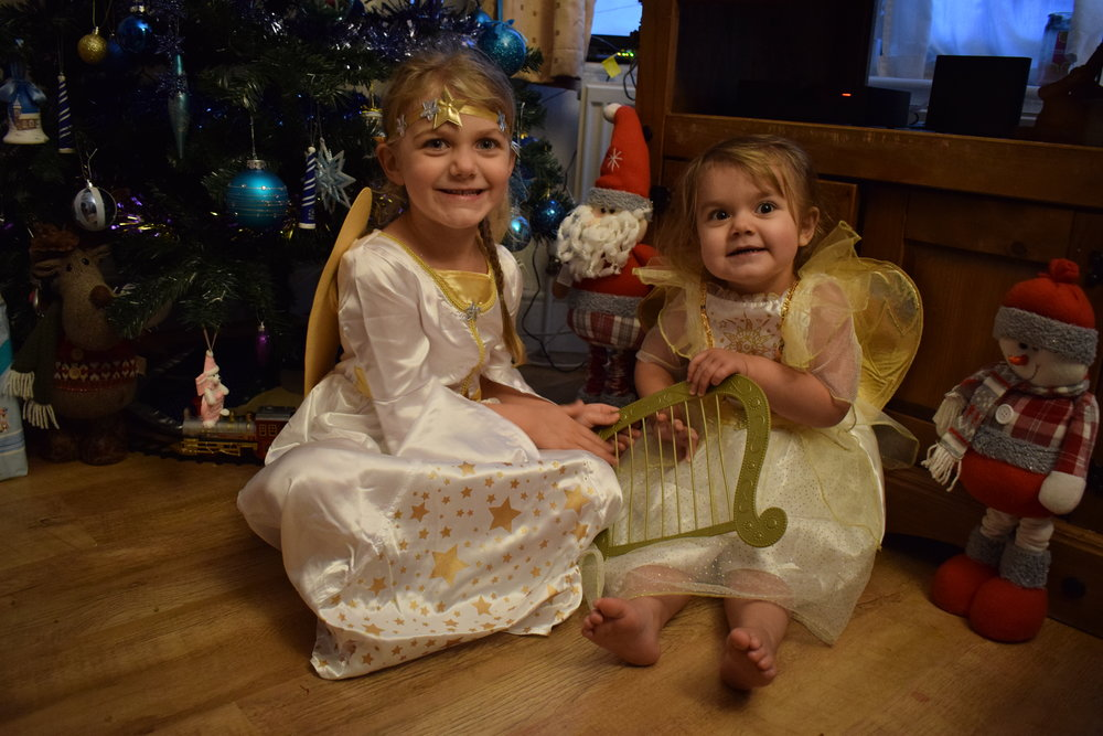My girls dressed up as Christmas angels