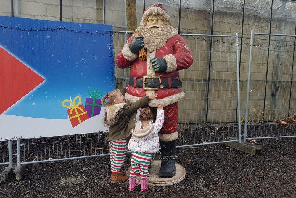 Hugging a Santa statue