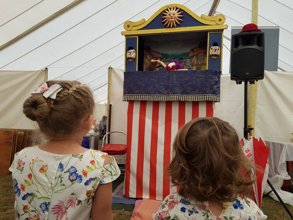 Egham Royal Show watching the Punch and Judy show