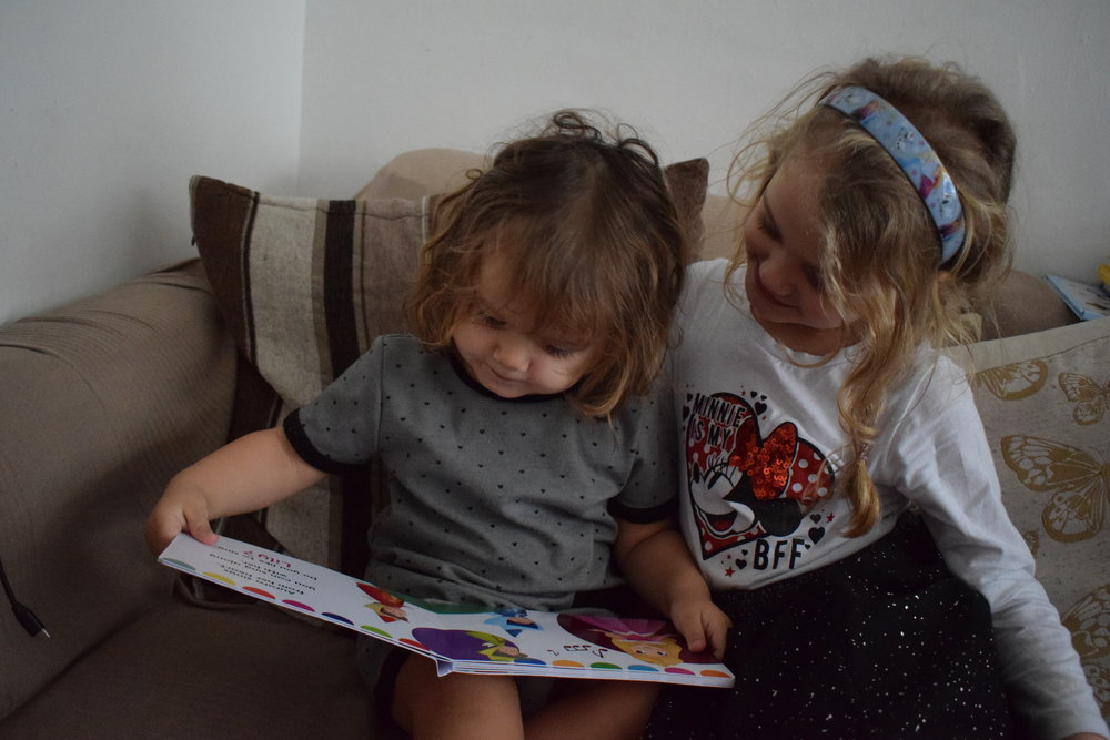Sisters reading together