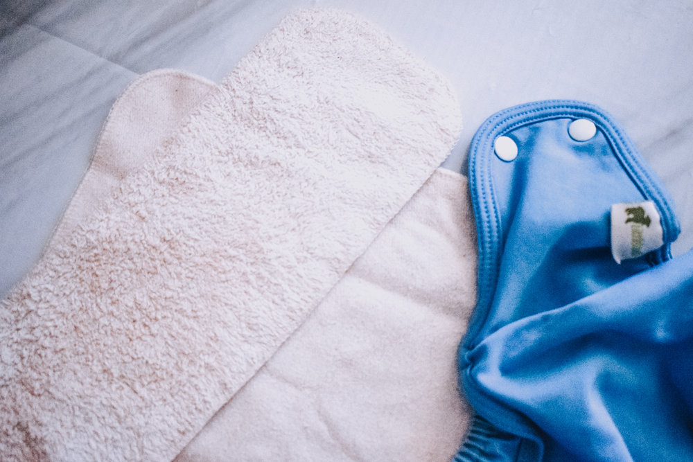 Pocket cloth nappy with bamboo insert and bamboo booster