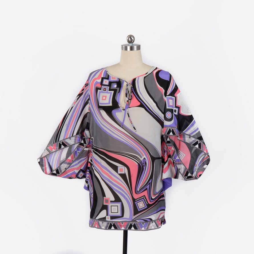 EMILIO PUCCI TOP $289 SIZE: US 10 BENEFITS: $198.2625 supports Union & Fifth Inc* Purple, black, gray, multicolor Emilio Pucci oversize sheer kaftan with print throughout and keyhole with tie closure at center front.
