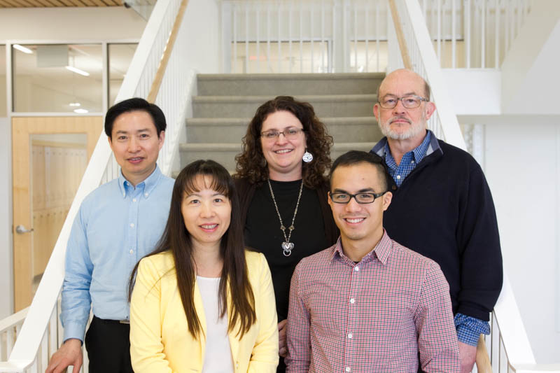 (back row, L-R) Shunqiang Li, Sherri R. Davis, R. Reid Townsend (front row, L-R) Li Ding, Kuan-lin Huang