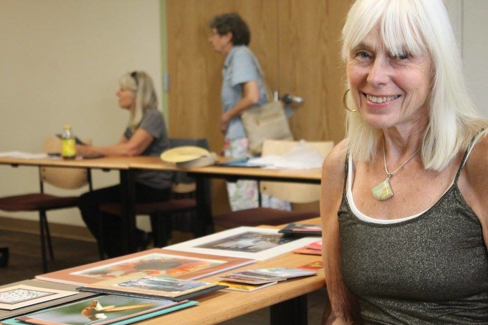 Artist Linda Greenwood shares her latest work at an Artist to Artist workshop: Working with Galleries, led by Vermont Artisan Design & Fine Art Gallery owner Greg Worden.