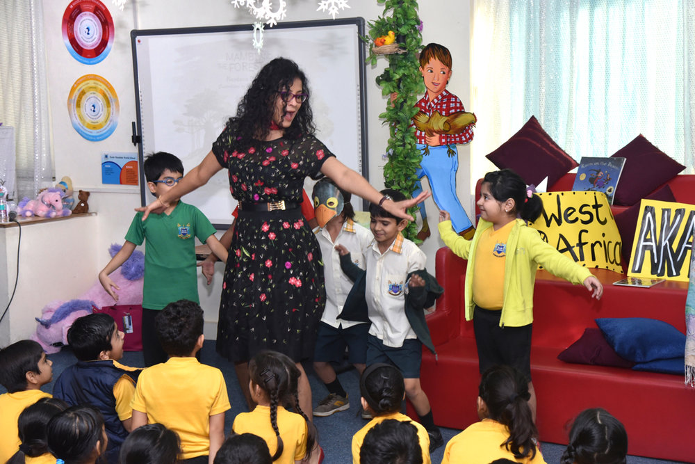 """Can you fly like Koko the Crow?"" Storytime in the library of Ecole Mondiale, Bombay,  January 28, 2016"