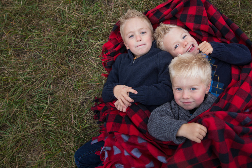 little brothers snuggling Edmonton park