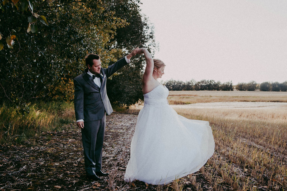 Groom dancing with bride | edmonton photographer