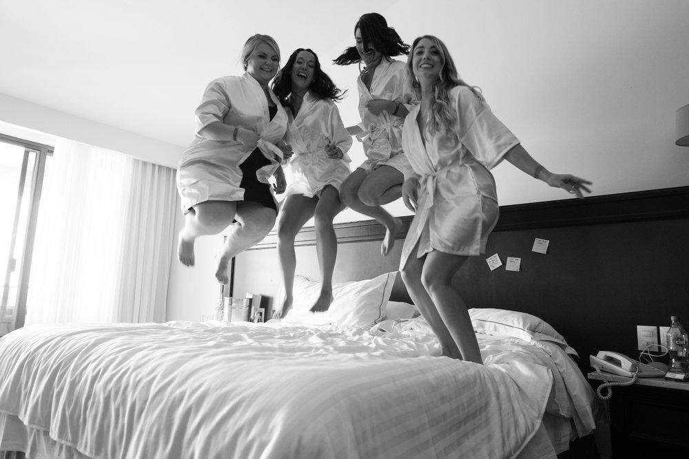 bridal party jumping on the bed Huatulco wedding | Edmonton destination wedding photographer