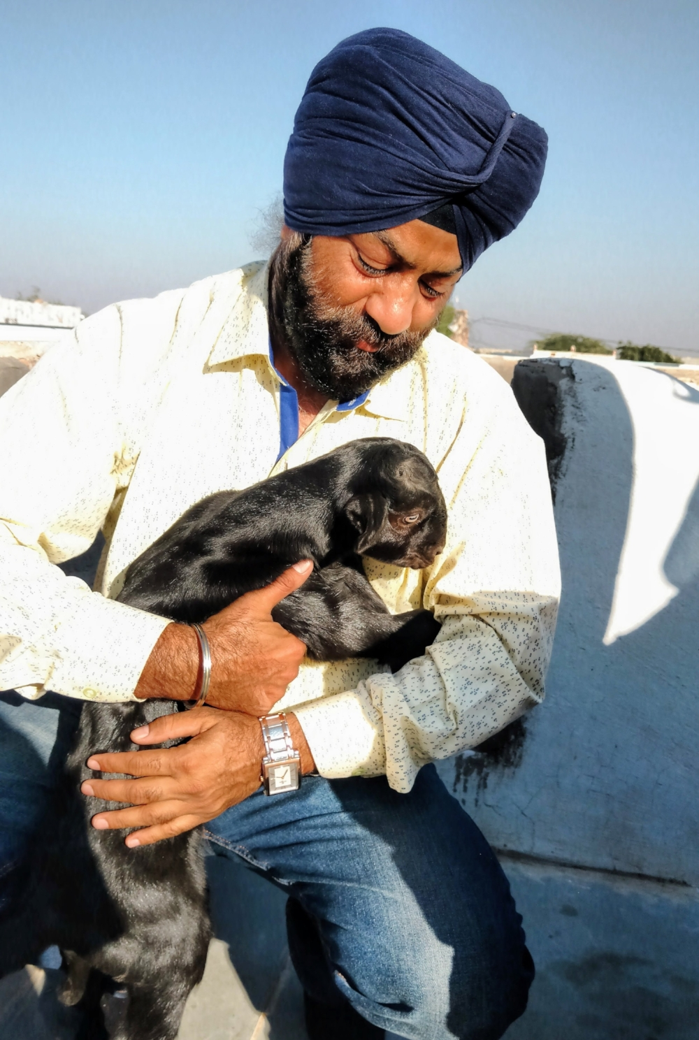 "Avtar Singh, my Indian driver, tour adviser and interpreter, shown here in his ""Happy Place"".  He is an animal lover, and a devoted Sikh with a lovely extended family."