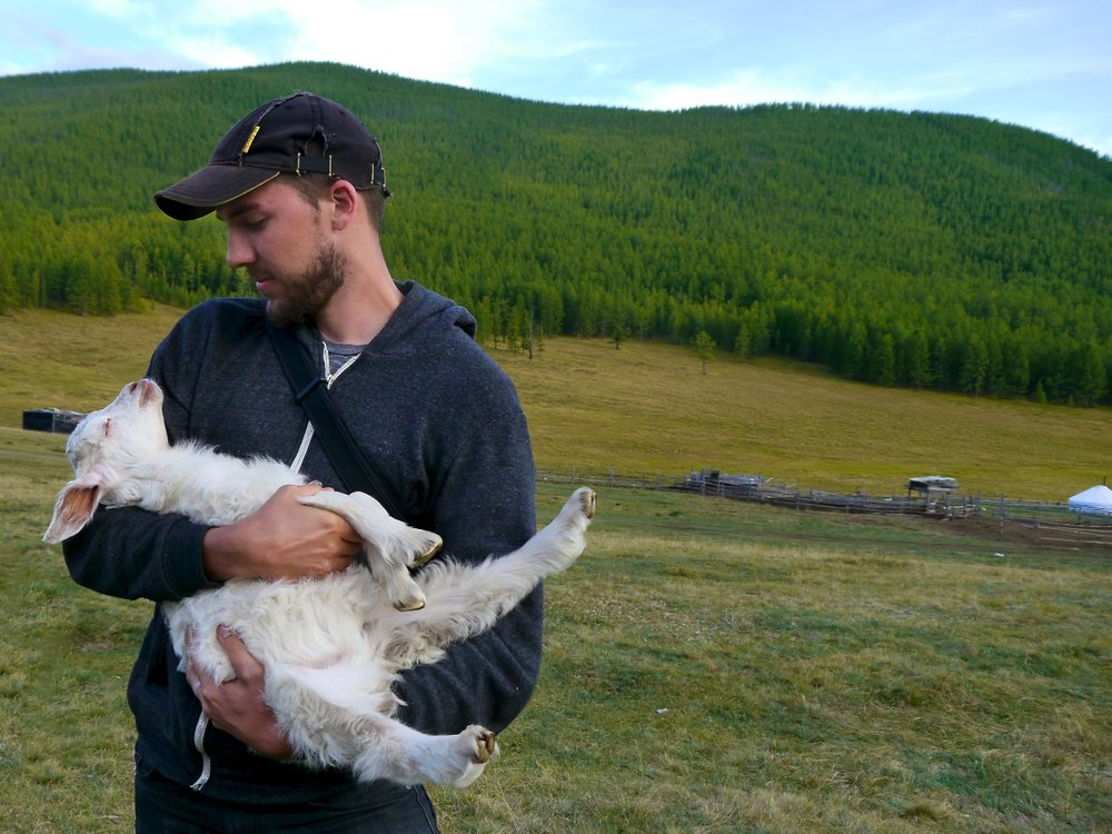 me with vasya – this lamb's mother died last winter and taigana has taken vasya in as a pet to nurse her