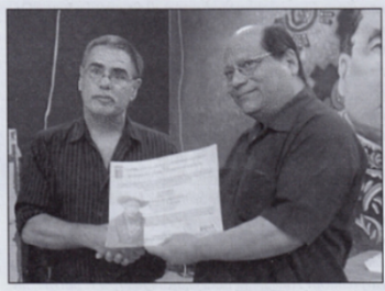Michael J. Schroeder receives City of Managua Recognition, presented by Clemente Francisco Guido Martínez, General Director of Culture and Historical Heritage, Office of the Mayor, Managua, August 2017.