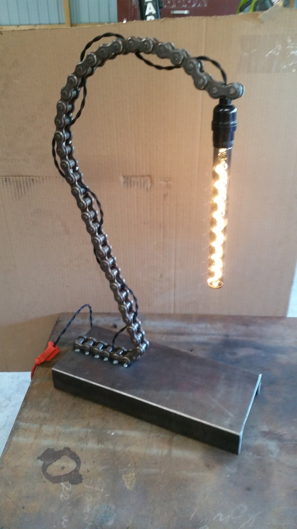 Desk lamp from an old forklift chain and channel.