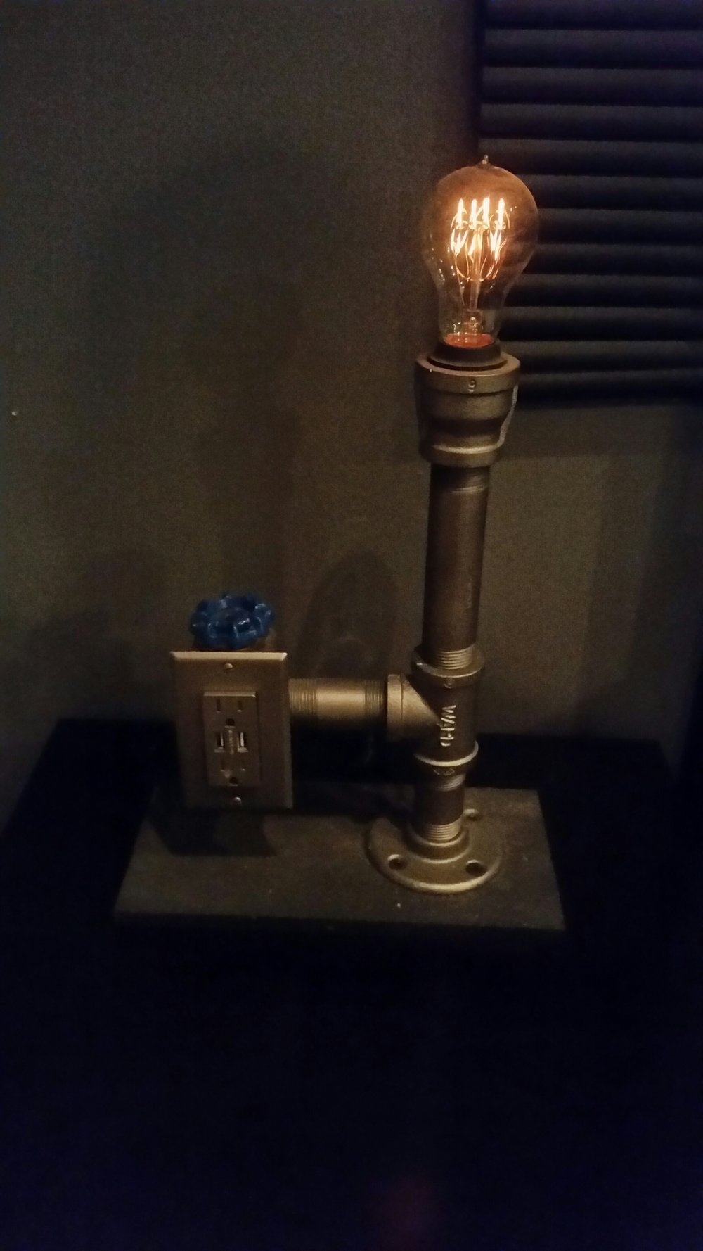 Pipe lamp with Edison bulb and garden faucet as switch/dimmer.